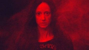 Mandy bathed in red light and smoke