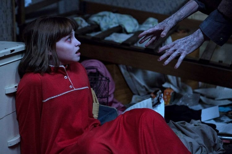 The ghost of Bill Wilkins grabs at young Janet in The Conjuring 2