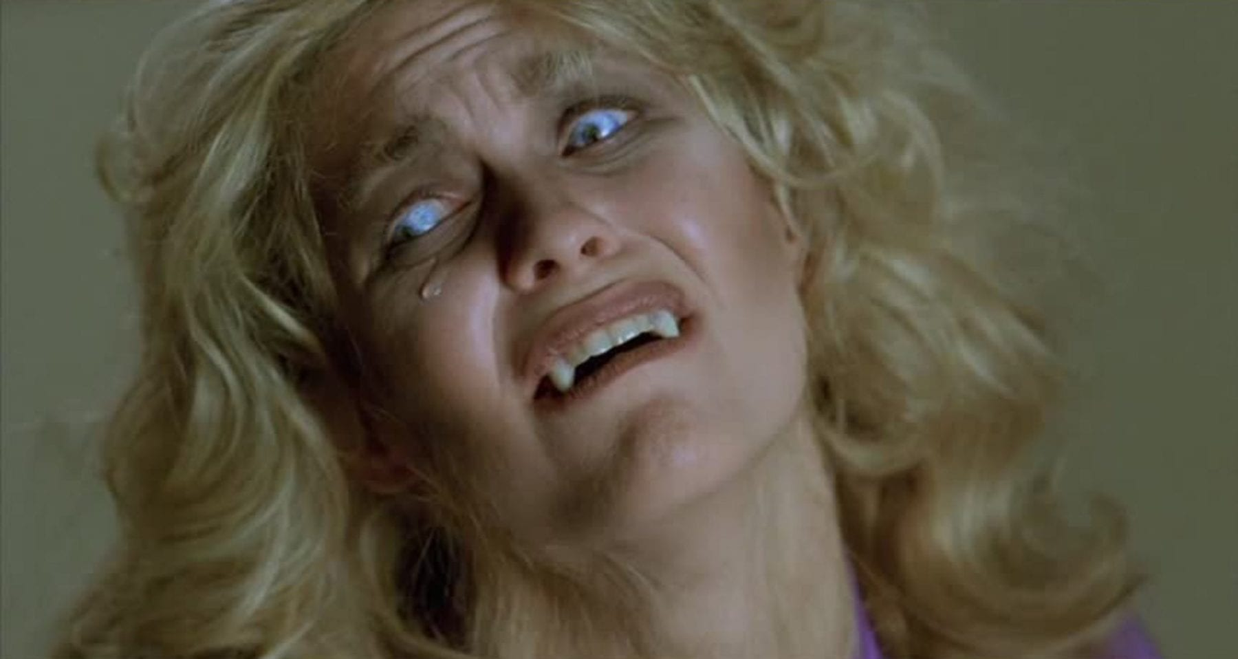 Dee Wallace transforming into a werewolf in The Howling