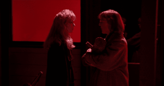 the Log Lady meets Laura Palmer outside the bang bang bar and gives her some advice