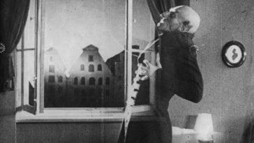 Nosferatu in front of an open window, struck by sunlight