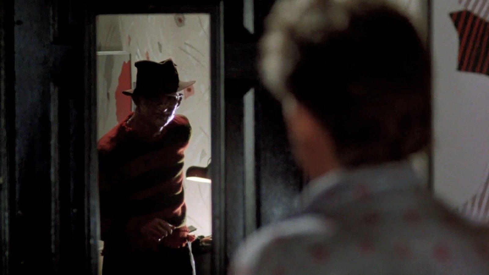 Freddy (Robert Engund) looks ovingly into Jesse (Mark Patton)s eyes.