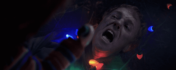 Chucky (Mark Hamill)'s soon-to-be-victim Shame (David Lewis) in Child's Play (2019.)