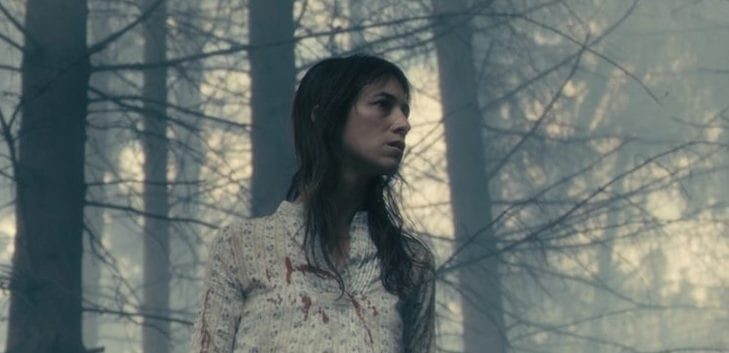 Woman with bloody shirt in the woods from Antichrist, lars von trier