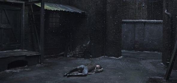 Protagonist from Lars von Trier's Nymphomaniac lying in alleyway