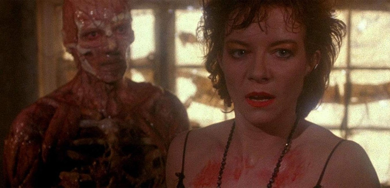 Frank as skeleton and some flesh and Julia turns away from him in horror Hellraiser