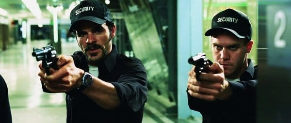 Mall cops with raised guns from Dawn of the Dead remake.