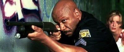 Actor Ving Rhames raises a gun in Dawn of the Dead remake.