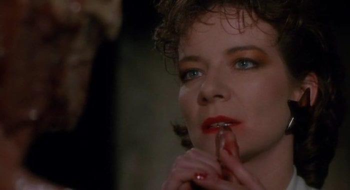 Julia brushes Franks finger over her lips in Hellraiser