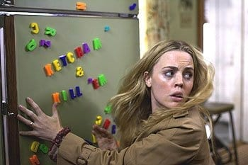 "Woman Kathy Lutz finds the magnets on her fridge have been rearranged by evil spirits to say ""Katch'em & Kill'em"" in The Amityville Horror (2005)."