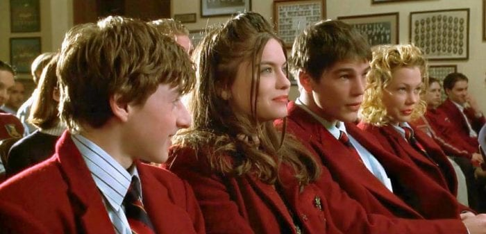 Charlie, Sarah, John and Molly sit together during a school assembly