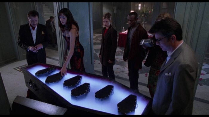 The party guests at the House on Haunted Hill get guns presented to them in a row of coffins.