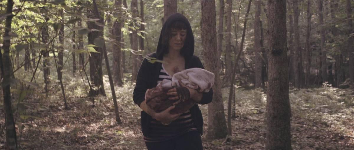 Hoffman as Amanda cradling her baby in Get My Gun