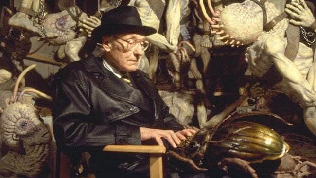 William S Burroughs in Naked Lunch sitting with the special effects aliens