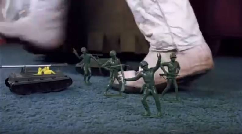 Plastic army toys are on the floor of a house that the army raids