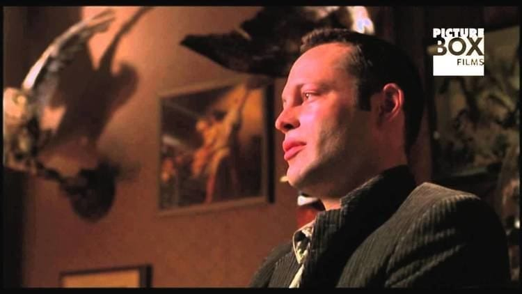 Vince Vaughn as Norman Bates sits in the motel office parlor with blurred taxidermied birds in the background.