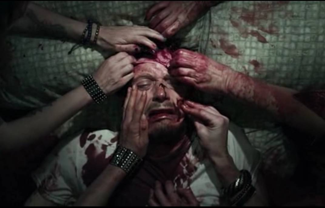 The girls all tear at Frank's face as he screams in both fear and pain