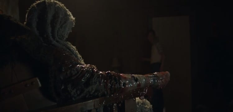 Richie Grenadine is show partially transformed into a mutant monster with a tentacle arm as his son Timmy stands aghast at the door in the background. Richie's head is covered with a cloth.