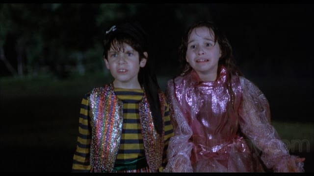 A young girl in a princess costume and a young boy in a pirate costume react in horror.