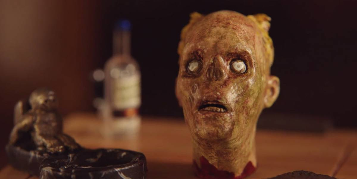 """A close-up shot of the corpse-like severed head doll from """"The House of the Head."""""""