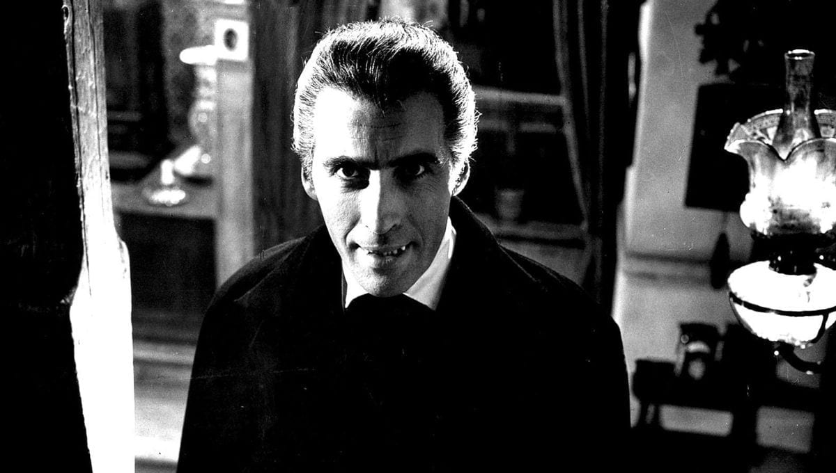 Christopher Lee posing as Dracula