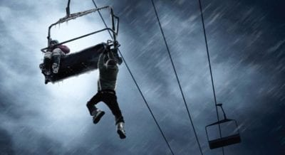 Man hanging from ski lift in Frozen horror movie