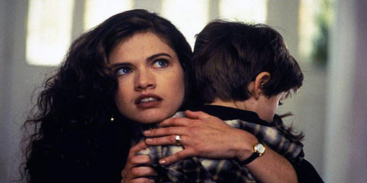 The main character Nancy (Heather Langenkamp) comforting and hugging her young son, Dylan (Miko Hughes)
