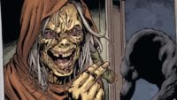 A comic-book graphic shows The Creep smiling and holding a severed with a shadowy werewolf in the background