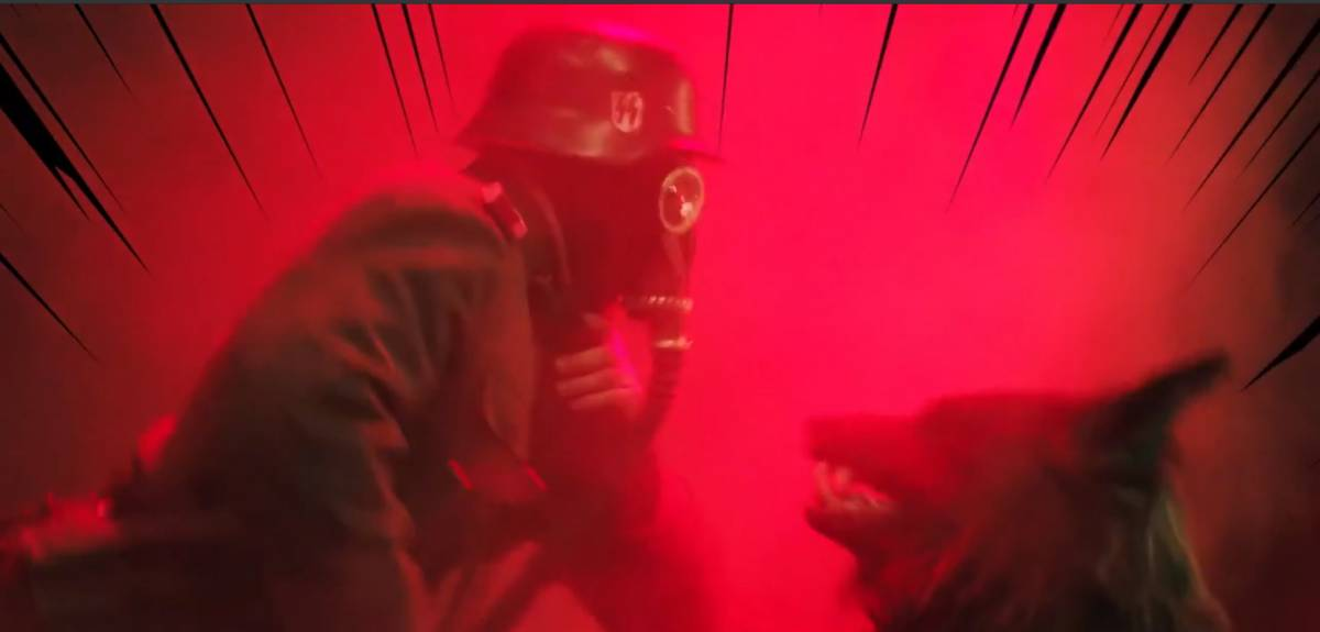 A wolf holds a nazi wearing a gas mask up by his throat in a scene that is stylized like a comic book.