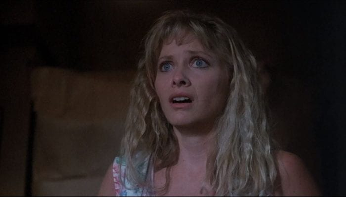 Barbara Crampton looks terrified in Chopping Mall