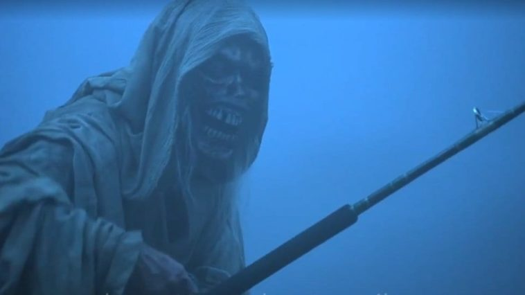 The shrouded and corpse-like Creep holds a fishing pole before a foggy background