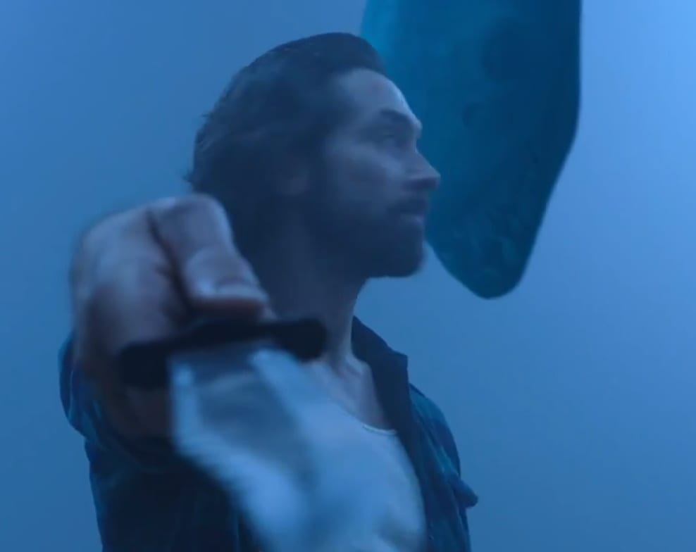 Chet holds a large blade towards the viewer while a giant lake monster looms over him from behind.