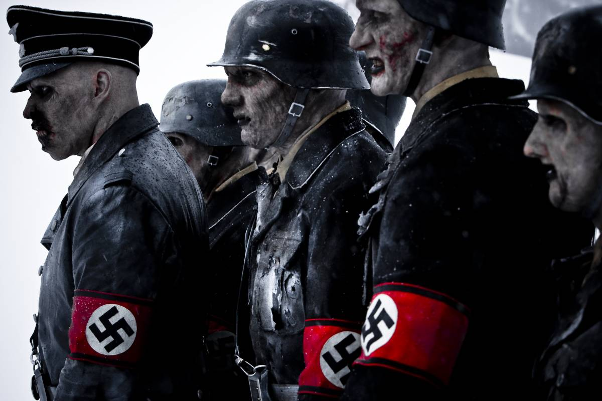 A group of Nazi zombie soldiers stand in profile.