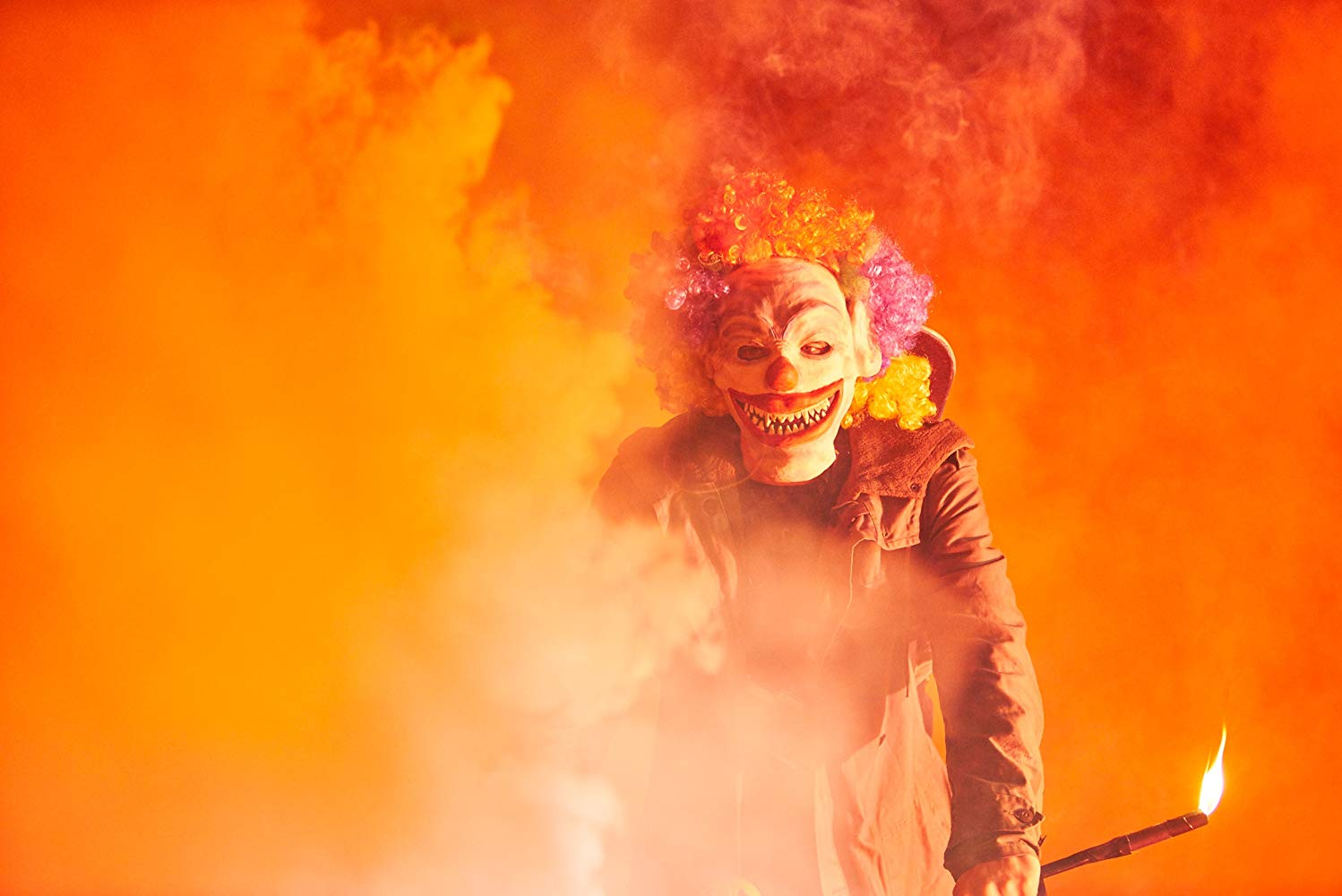 One of the bullies in the film wears a clown mask and wields a flare, giving off a bright orange light