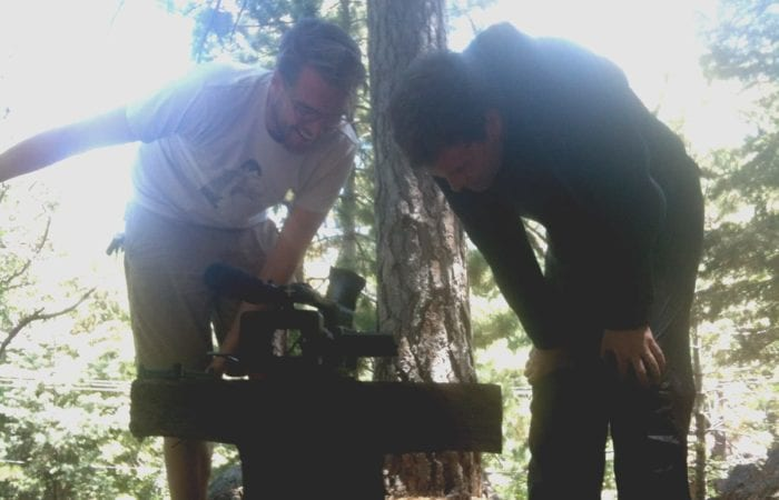 Brice and Duplass checking the camera on set in the woods