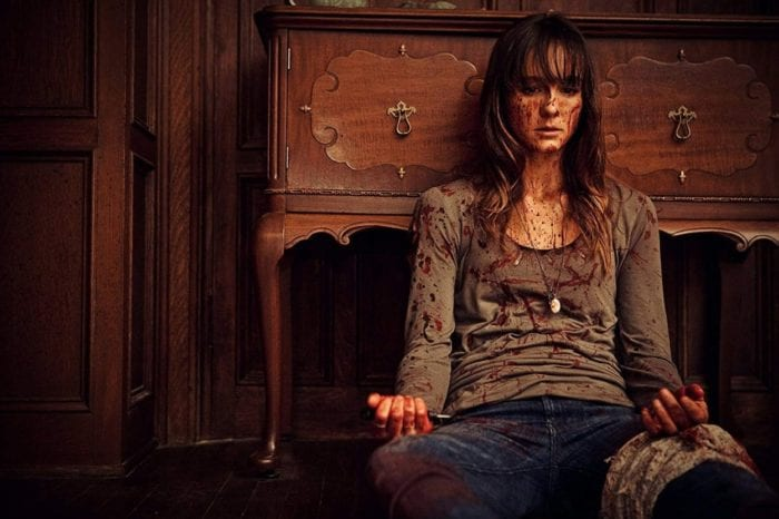 Sharni Vinson's Erin sits against a bureau covered in blood and injured