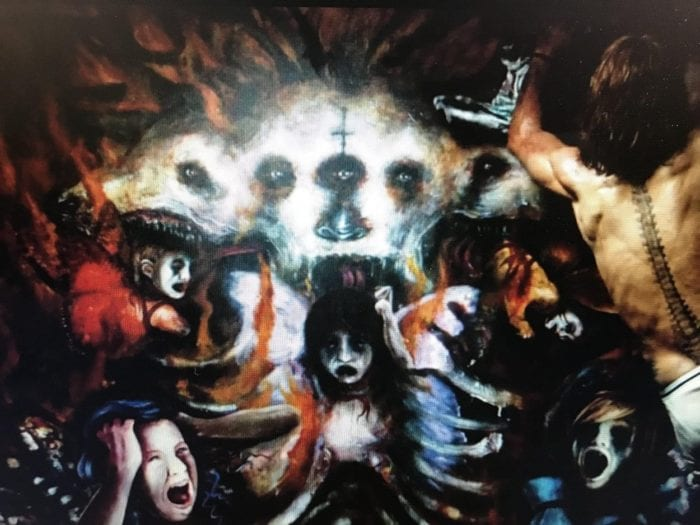 The painting Ethan Embry's character works on in The Devil's Candy, which features a horrific tableau of Cerberus and screaming children