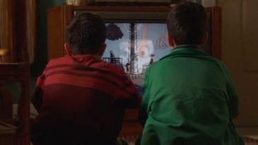 Twin boys watch Candle Cove on an old television set.