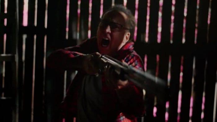 Nathan Gardner screams while holding his gun at an unseen attacker