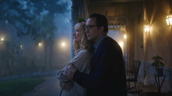 Nathan holds Theresa on the porch of their farm