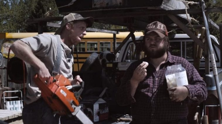 Tucker and Dale chat in a parking lot