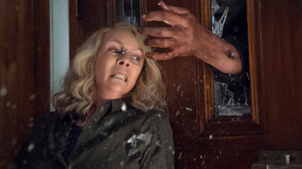 Michael breaks through glass to grab Laurie.