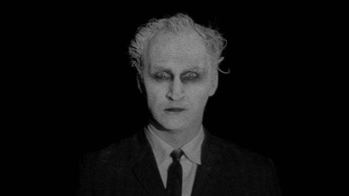 The pale, raccoon-eyed, suit and tie clad apparition that appears throughout Carnival of Souls, staring into the camera against a completely black background.