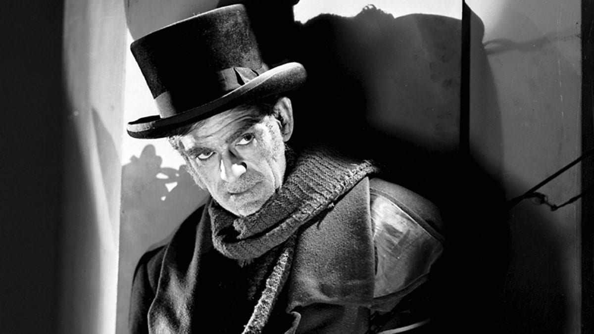 Boris Karloff as John Gray looking off behind the camera menacingly