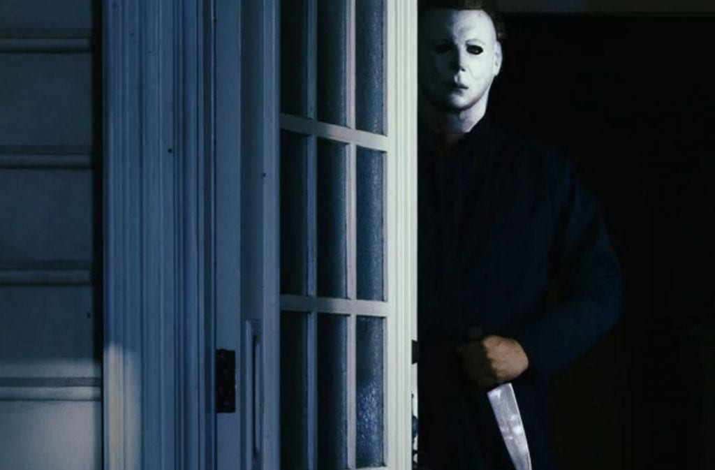 Michael Myers stands with a knife, stalking.
