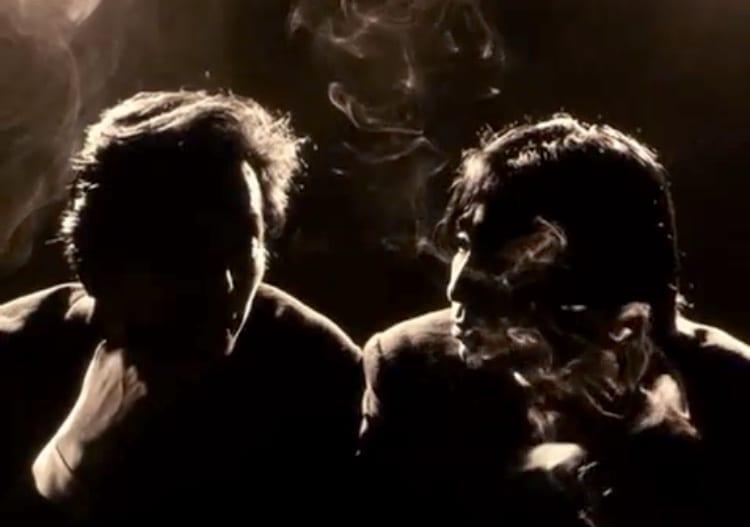 Japanese men smoking a cigarette