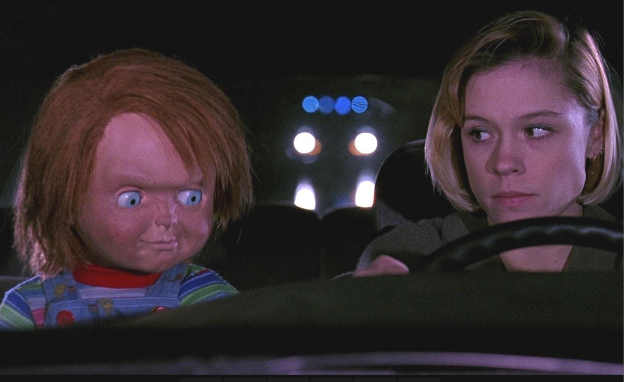 Chucky and Kyle driving in a car in Child's Play 2
