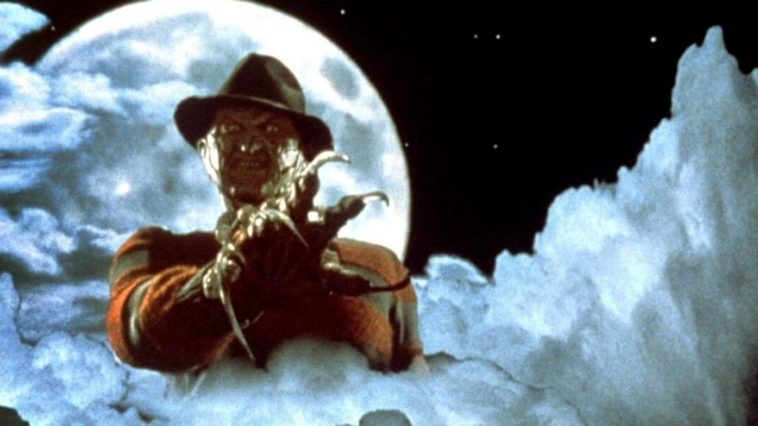Freddy Krueger blends in with the clouds while the moon is full behind him