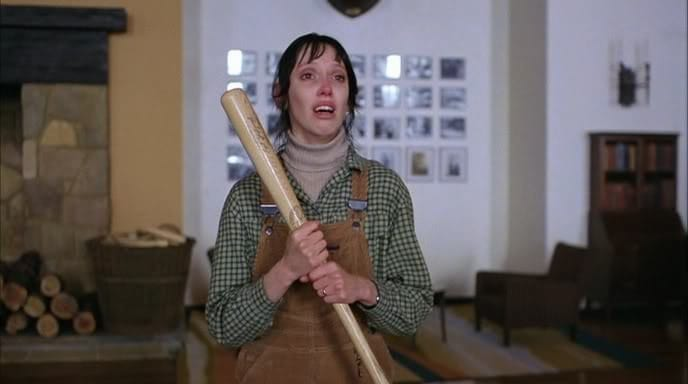 Shelley Duvall as Wendy Torrance clutches baseball bat while she cries confusedly.