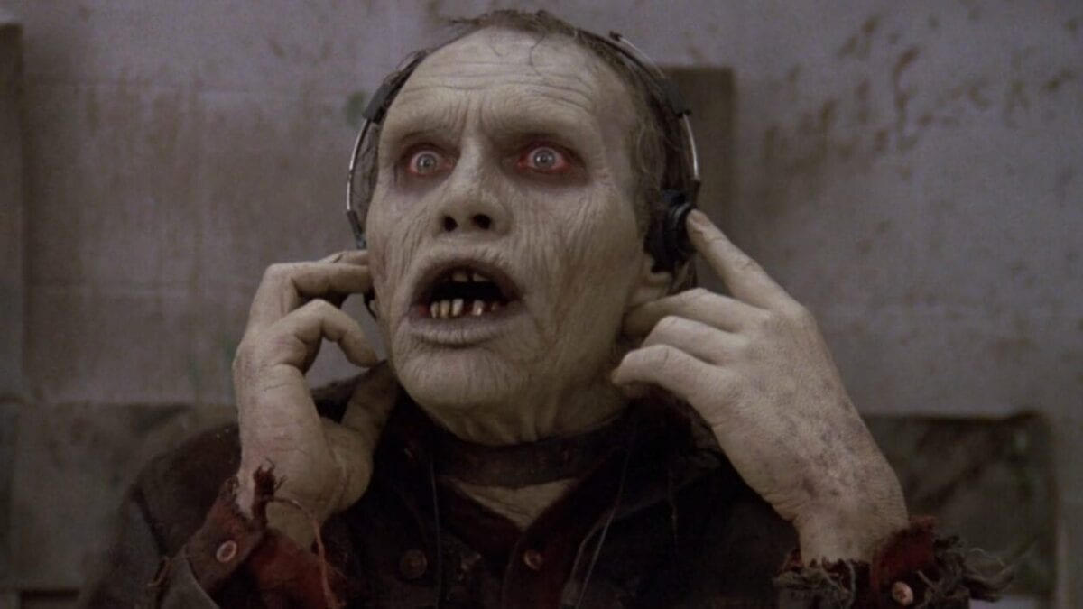 Bub presses headphones against his ears.